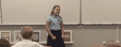 A student addresses a classroom