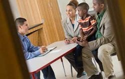 A family meets with an enrollment counselor