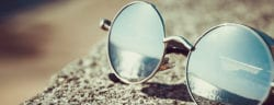 A pair of glasses in front of water