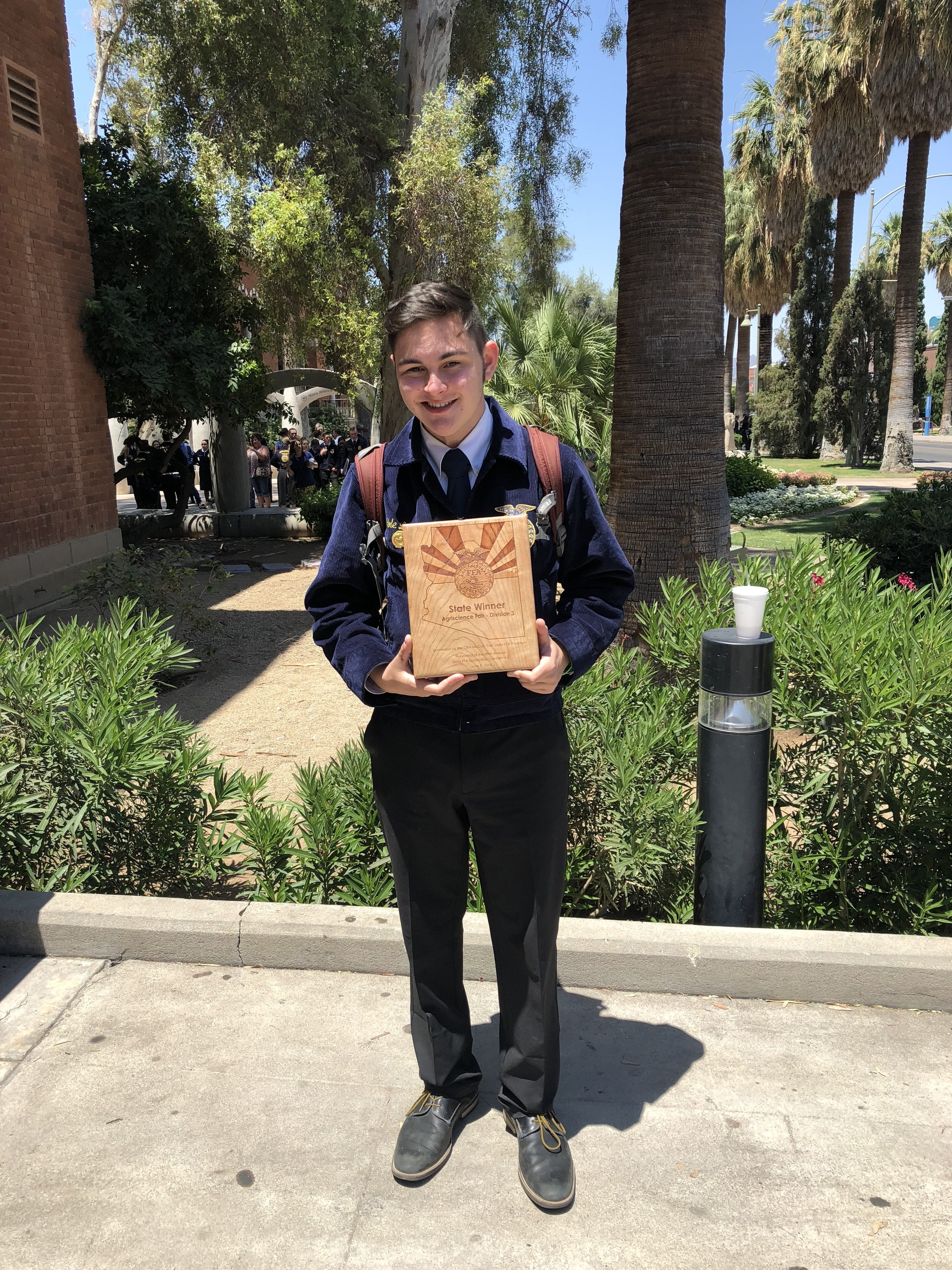 Cole Lozon posing at the national science fair
