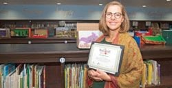 Mrs Flower displaying an award