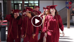 Seniors walk in their graduation gear