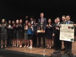 Winners of a speech and debate contest stand on stage