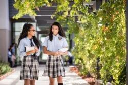 high school girls walking on campus
