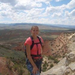 teacher standing at grand canyon