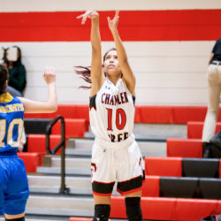 Justine Cooper shoots a basketball