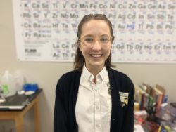Audrey Beermann in front of periodic table