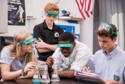 high school students doing a science experiment
