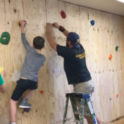 building a rock climbing wall inside archway trivium east