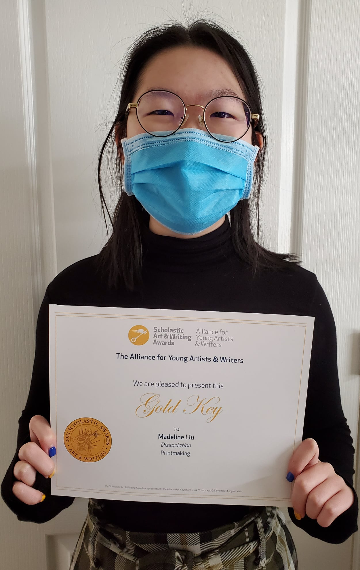girl holding certificate
